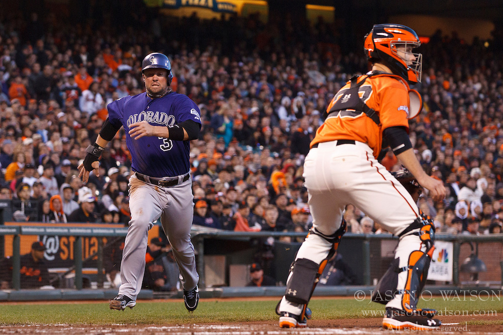 SAN FRANCISCO, CA - MAY 24: Michael Cuddyer #3 of the Colorado Rockies scores a run past Buster Posey #28 of the San Francisco Giants during the fourth inning at AT&T Park on May 24, 2013 in San Francisco, California. (Photo by Jason O. Watson/Getty Images) *** Local Caption *** Michael Cuddyer; Buster Posey