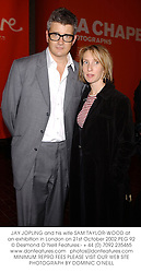 JAY JOPLING and his wife SAM TAYLOR-WOOD at an exhibition in London on 21st October 2002.PEG 92