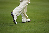 December 2005: A pair of FootJoy golf shoes walk down the fairway green grass. Golf Sport Detail, graphic, art, stock, illustration, atmosphere.