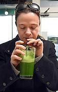 Mara Lavitt /For Hearst Connecticut Media<br /> February 6, 2016<br /> Catch A Healthy Habit Cafe, Fairfield. Fernanda Marchi of Fairfield drinks The Tara, made of green apple, celery, cucumber, kale, romaine, lemon and ginger.