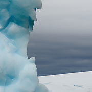 Intricate shapes carved into an Antarctic iceberg floating near Two Hummock Island, Antarctica.