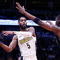 01 April 2018: Denver Nuggets forward Will Barton (5) passes the ball past Milwaukee Bucks guard Tony Snell (21) during the Denver Nuggets 128-125 victory over the Milwaukee Bucks, at the Pepsi Center, Denver, Colorado, USA.