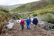 Hywel Thomas, Jaqui Bugden and Gavin Gatehouse walking away from the inlet entrance at the weir of their new community hydro project.  Ynni Anafon Energy, one of the largest community owned hydro projects in the UK. The site of the Anafon Hydro lies in the Anafon valley in the Carneddau massif which rises immediately south of the village of Abergwyngregyn just inside the northern boundary of the Snowdonia National Park and 4 km west-south-west of Llanfairfechan.