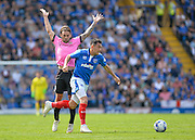 Portsmouth midfielder Gary Roberts takes on Northampton Town Midfielder Ricky Holmes during the Sky Bet League 2 match between Portsmouth and Northampton Town at Fratton Park, Portsmouth, England on 7 May 2016. Photo by Adam Rivers.