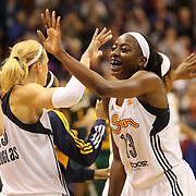 Chiney Ogwumike,  (right), Connecticut Sun, celebrates with team mates after their teams first victory of the season during the Connecticut Sun Vs Seattle Storm WNBA regular season game at Mohegan Sun Arena, Uncasville, Connecticut, USA. 23rd May 2014. Photo Tim Clayton