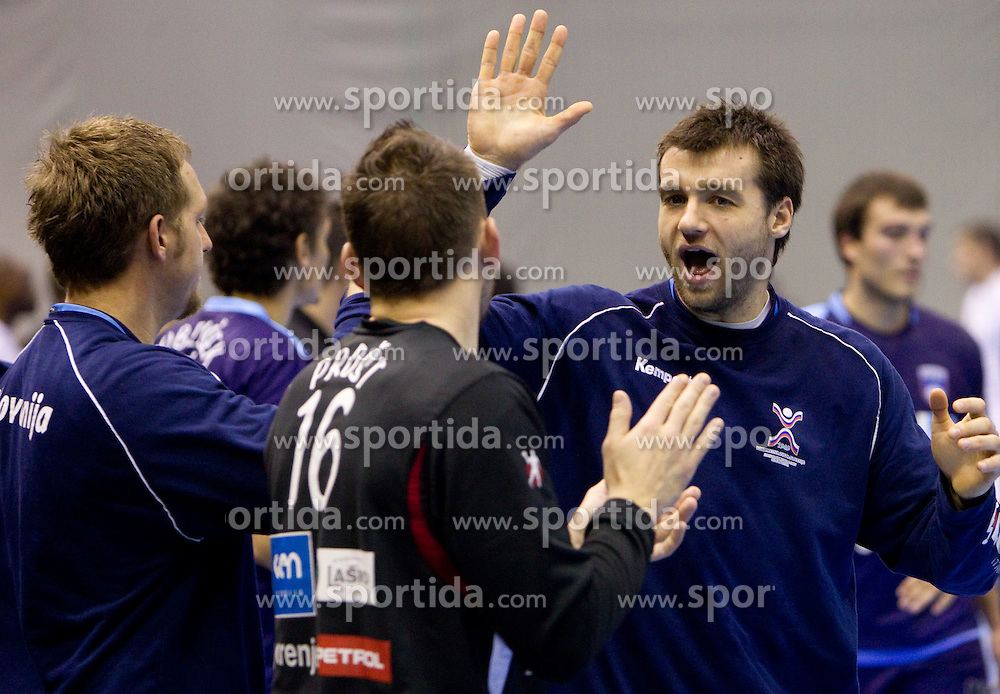 Primoz Prost of Slovenia and Klemen Cehte of Slovenia celebrate after the handball match between National teams of Slovenia and Portugal in the Qualifications of the EHF EURO 2012, on October 27, 2010 at Arena Zlatorog, Celje, Slovenia. Slovenia defeated Portugal 34 - 31.(Photo By Vid Ponikvar / Sportida.com)