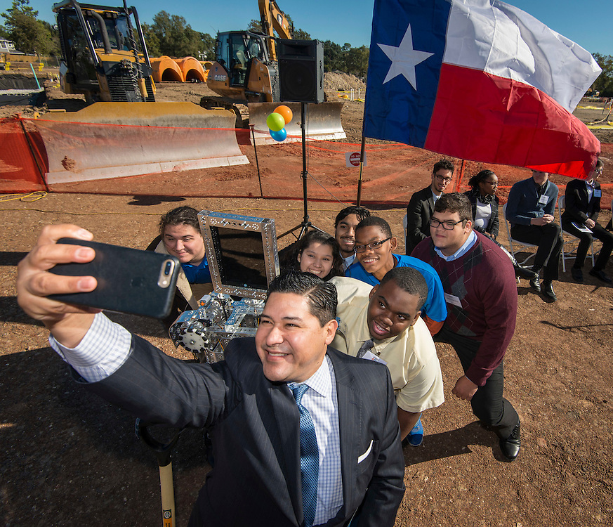 Houston ISD Superintendent Richard Carranza takes a selfie with students during a groundbreaking ceremony for the new Energy Institute High School, November 19, 2016.