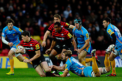 Saracens Outside Centre (#13) Joel Tomkins is tackled by Wasps Lock (#4) Joe Launchbury during the second half of the match - Photo mandatory by-line: Rogan Thomson/JMP - Tel: Mobile: 07966 386802 04/11/2012 - SPORT - RUGBY - Vicarage Road - Watford. Saracens v London Wasps - Aviva Premiership