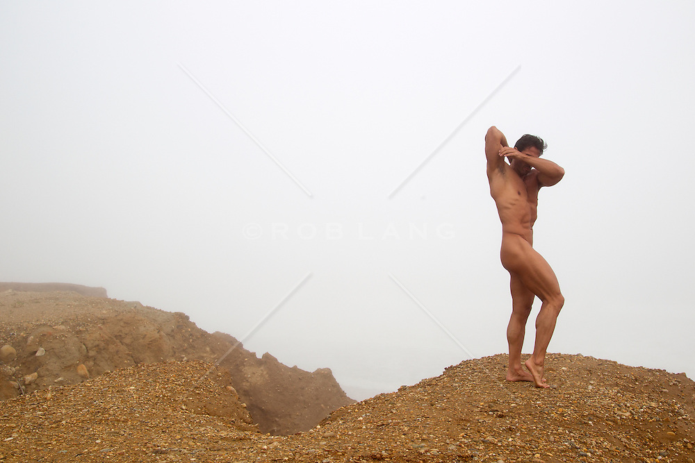 naked bodybuilder on a cliff in Montauk, NY