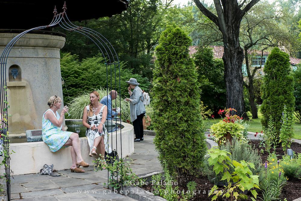 A cocktail party around the Sense Circle at Caramoor in Katonah New York on July 22, 2016. <br /> (photo by Gabe Palacio)