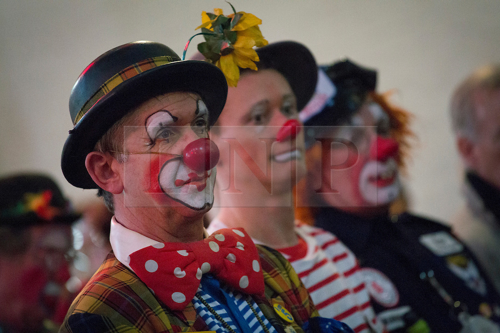 © licensed to London News Pictures. London, UK 03/02/2013. Clowns attending the church service in memory of Joseph Grimaldi, the UK's most celebrated clown, at Holy Trinity Church in Dalston, London. Photo credit: Tolga Akmen/LNP