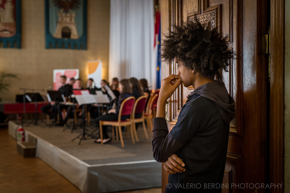 A music student observing performances of his colleagues in Vienna.