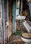 The exterior wall of this corner bathroom, of an abandoned house in Belews Creek, NC have deteriorated.  The room now exposed to the elements.