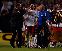 Photo: Henry Browne.<br /> Arsenal v FC Thun. UEFA Champions League.<br /> 14/09/2005.<br /> Alen Orman of Thun goes off after the clash with Van Persie.