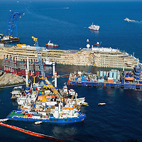 ISOLA DEL GIGLIO, ITALY - SEPTEMBER 18:  The right  side of the Costa Concordia is seen  on September 18, 2013 in Isola del Giglio, Italy. The vessel, which sank on January 12, 2012, was successfully righted during a painstaking operation yesterday morning. The ship will eventually be towed away and scrapped. ItÊwas the first time the procedure, known as parbuckling, hadÊbeen carried out on a vessel as large as Costa Concordia.  (Photo by Marco Secchi/Getty Images)