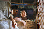 Cai Be, on a bank of the first arm (Tien Gang) of the Mekong River, Vietnam. .March 18th 2007..Some kids of the village..