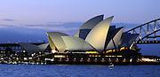 AUSTRALIA - SYDNEY  Sydney Opera House and Harbour Bridge seen at dusk from across farm cove at The Royal Botanical Gardens in Sydney City Centre  04/01/2010. STEPHEN SIMPSON...