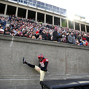 David Bicknell, Harvard, warming up on the sideline during the Harvard Vs Yale, College Football, Ivy League deciding game, Harvard Stadium, Boston, Massachusetts, USA. 22nd November 2014. Photo Tim Clayton