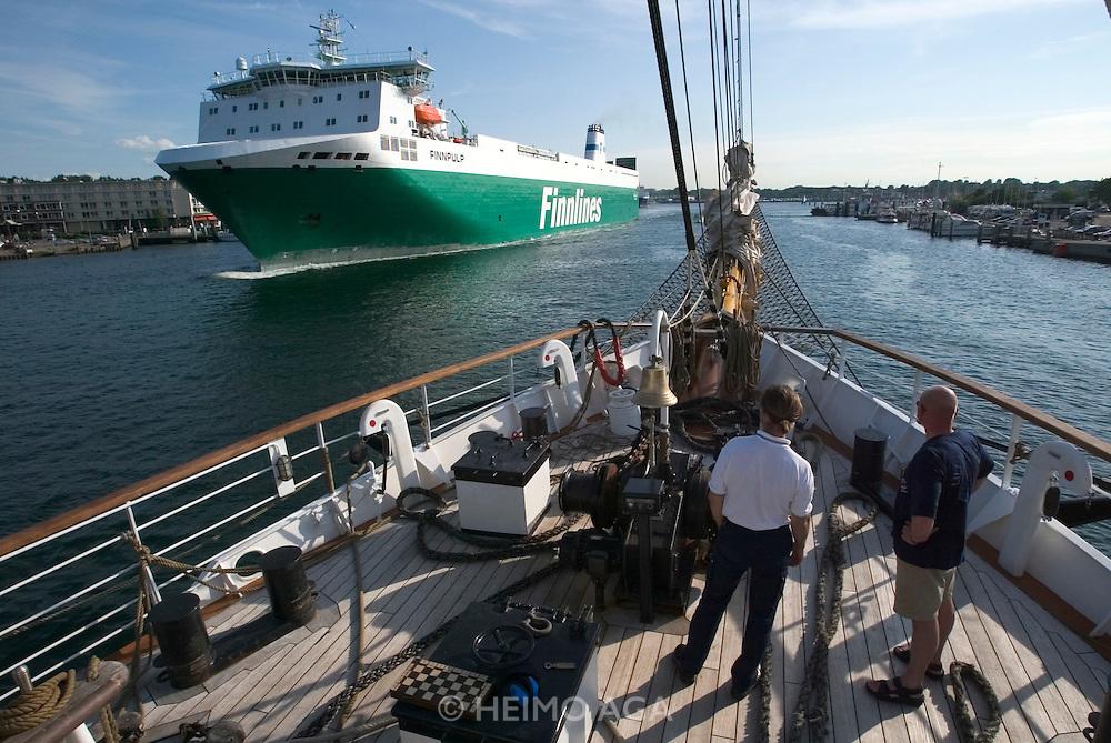 "The ""Lili Marleen"" (luxurious sailing ship of Deilmann Cruises) passing a Finnlines ferry while entering Travemu?nde."