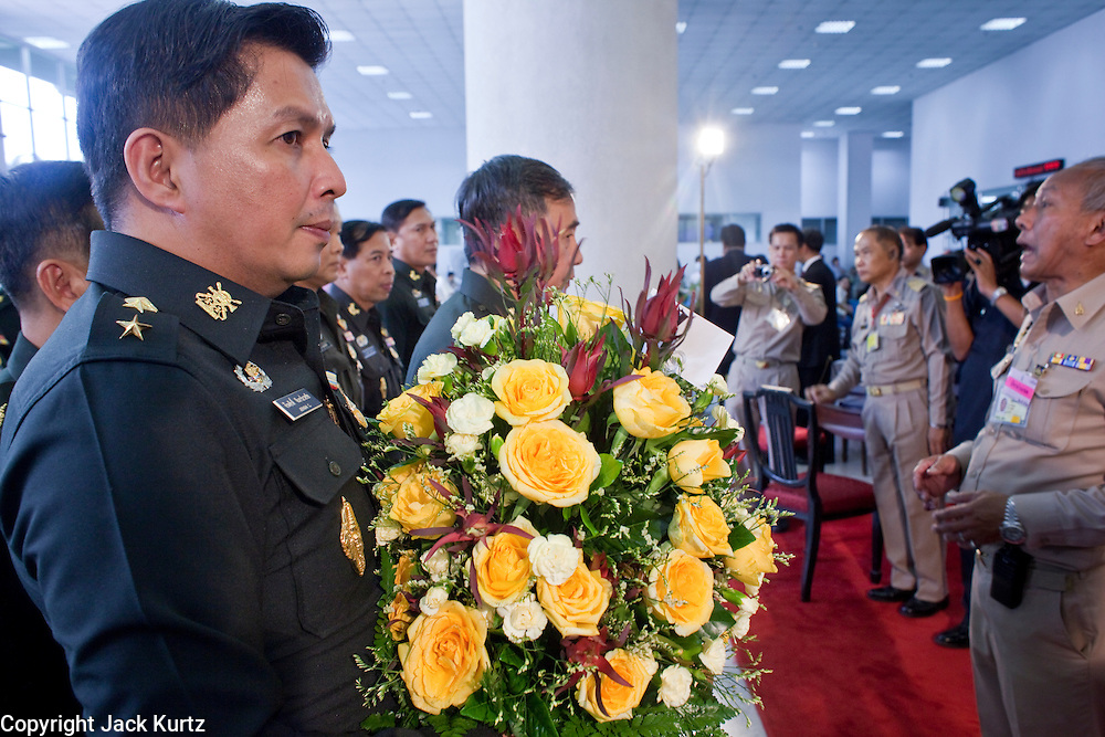 Sept. 22, 2009 -- BANGKOK, THAILAND:  Members of the Thai military bring flowers to King Bhumibol Adulyadej, the 81-year-old King of Thailand. The King has been admitted to hospital suffering from a fever. Doctors at Siriraj Hospital said the world's longest-serving monarch, had shown signs of fatigue and was being treated with antibiotics. King Bhumibol is deeply revered by most Thais and his health is a matter of public anxiety. His Majesty was admitted on Saturday suffering from a fever, fatigue and loss of appetite. Doctors continued to treat the King with intravenous drips and antibiotics, hospital officials said. More than 3,500 people have come to the hospital to pray for the King's speedy recovery and to sign get well cards for him.  Photo by Jack Kurtz