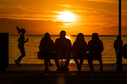 © Licensed to London News Pictures<br /> 09/06/2019 Aberystwyth UK. <br /> The setting sun dramatically lights up the evening sky in Aberystwyth, west Wales , at the end of mixed day of sunny spells and heavy downpours. Wet weather is forecast widely across southern and central Britain in the next 24 hours with scattered heavy or thundery showers mixed with longer outbreaks of rain.<br /> photo credit: Keith Morris/LNP