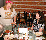 "Kristin Nader (standing) as Ivy Kerf during Mayhem & Mystery's production of ""Campground Chaos"" at the Spaghetti Warehouse in downtown Dayton, Monday, July 9, 2012."