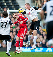 LONDON, ENGLAND - Saturday, October 31, 2009: Liverpool's Fernando Torres and Fulham's Brede Hangeland during the Premiership match at Craven Cottage. (Pic by David Rawcliffe/Propaganda)