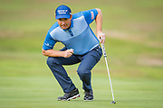 Padraig Harrington of Ireland sizes up a putt during the British Masters 2018 at Walton Heath Golf Course, Walton On the Hill, Surrey on 12 October 2018. Picture by Martin Cole.