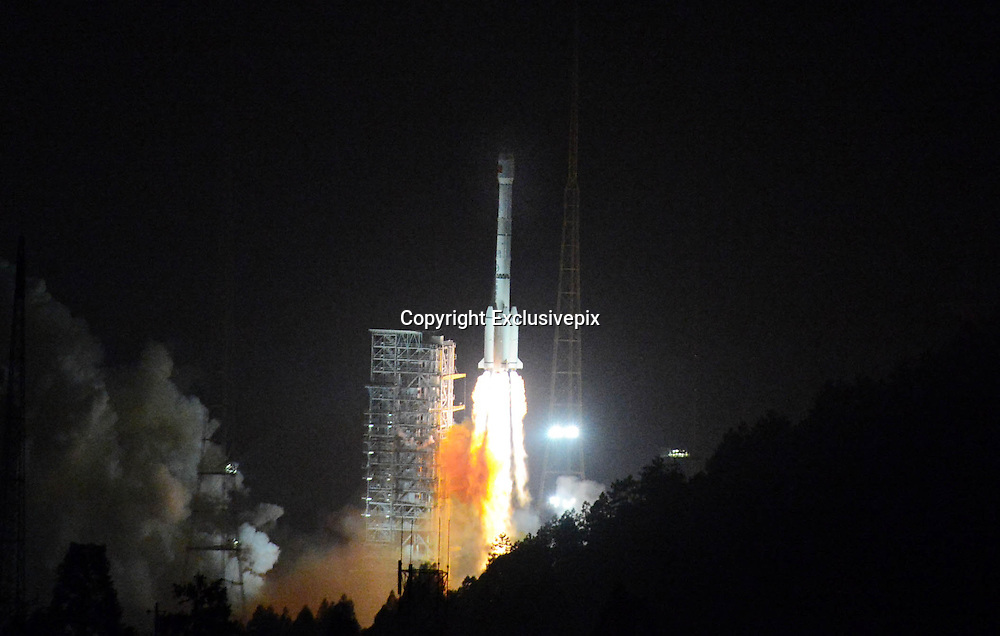 XICHANG, CHINA - DECEMBER 02:  china out - finland out <br /> <br /> China Launches Its First Moon Rover <br /> <br /> A Long March-3B carrier rocket carrying China's Chang'e-3 lunar probe takes off from the Xichang Satellite Launch Center on December 2, 2013 in Xichang, Sichuan Province of China. China successfully sent the Chang'e-3 lunar probe with its first moon rover aboard into orbit on Monday morning. <br /> ©Exclusivepix