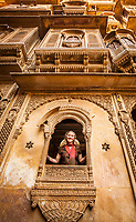 A Caucasian tourist posing for a picture in one of the many amazing Havelis in Jaisalmer, Rajasthan, India.