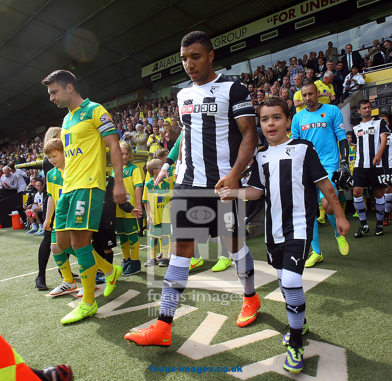 Russell Martin of Norwich and Troy Deeney of Watford lead the teams out before the Sky Bet Championship match at Carrow Road, Norwich<br /> Picture by Paul Chesterton/Focus Images Ltd +44 7904 640267<br /> 16/08/2014