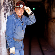 "Sonny Tovar was born in Bisbee in 1935. He was 40 years old when the Queen Mine closed. He is now one of several retired miners who give daily tours of the mine. He says he still loves the smell of the mine. ""I enjoy the tours. I knew what I was talking about. I would put my heart into it. I felt proud to be a miner."""