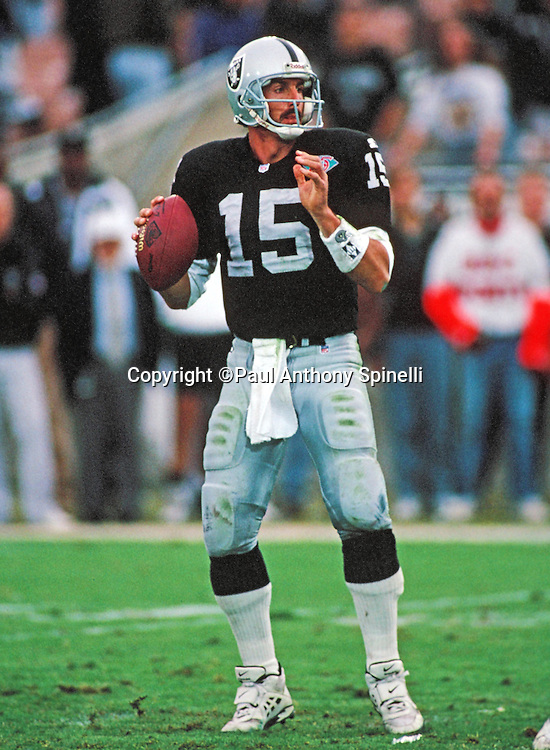 Los Angeles Raiders quarterback Jeff Hostetler (15) throws a pass during the NFL football game against the Denver Broncos on Dec. 11, 1994 in Los Angeles. The Raiders won the game 23-13. (©Paul Anthony Spinelli)