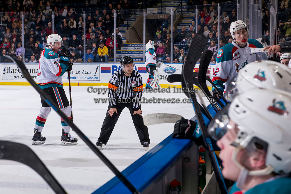KELOWNA, CANADA - FEBRUARY 23:  Referee Chris Crich speaks to the Kelowna Rockets' bench against the Kamloops Blazers on February 23, 2019 at Prospera Place in Kelowna, British Columbia, Canada.  (Photo by Marissa Baecker/Shoot the Breeze)