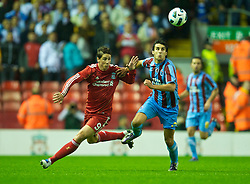 LIVERPOOL, ENGLAND - Thursday, August 19, 2010: Liverpool's Fernando Torres and Trabzonspor's Hrvoje Cale during the UEFA Europa League Play-Off 1st Leg match at Anfield. (Pic by: David Rawcliffe/Propaganda)