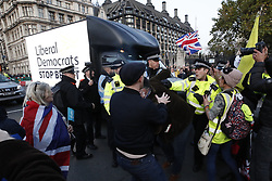 © Licensed to London News Pictures. 31/10/2019. London, UK. Anti-Brexit protesters surround a Liberal Democrat advertising van as they gather in Parliament Square on what would have been the United Kingdom's last day as a member of the European Union. The date of Brexit had been moved to January 31, 2020 after MPs failed to pass Prime Minister Boris Johnson's withdrawal agreement. Photo credit: Peter Macdiarmid/LNP