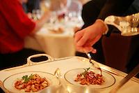 saucing a dish at the restaurant l'ambroisie, paris