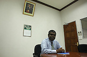 Under a portrait of President Gayoom is Mr Abdullah Naseer at his desk in the Fisheries Ministry, Republic of the Maldives. .