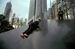 CHINA SHANGHAI NOV01 - Young boys play at marble decorations in Pudong Financial District.. . . jre/Photo by Jiri Rezac. . © Jiri Rezac 2001. . Contact: +44 (0) 7050 110 417. Mobile:  +44 (0) 7801 337 683. Office:  +44 (0) 20 8968 9635. . Email:   jiri@jirirezac.com. Web:     www.jirirezac.com