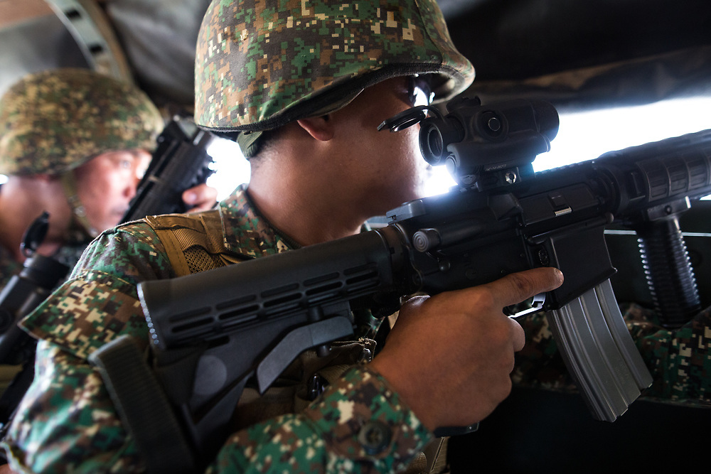MARAWI, PHILIPPINES - JUNE 9: Philippine marines on alert as they move inside the NO GO ZONE during a heavy fight in Marawi, southern Philippines on June 9, 2017. Philippine military jets fired rockets at militant positions on Friday as soldiers fought to wrest control of the southern city from gunmen linked to the Islamic State group. (Photo: Richard Atrero de Guzman/NUR Photo)