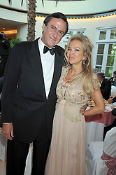 The MARQUESS & MARCHIONESS OF NORTHAMPTON at the annual Dog's Trust Honours Awards held at The Hurlingham Club, Fulham, London on 19th May 2009.
