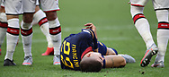 AS Roma's Italian defender Gianluca Mancini lays injured following a clash with an opponent during the Serie A match at Giuseppe Meazza, Milan. Picture date: 28th June 2020. Picture credit should read: Jonathan Moscrop/Sportimage