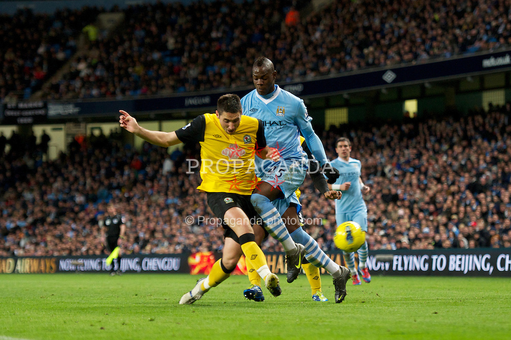 MANCHESTER, ENGLAND - Saturday, February 25, 2012: Manchester City's Mario Balotelli in action against Blackburn Rovers during the Premiership match at City of Manchester Stadium. (Pic by David Rawcliffe/Propaganda)