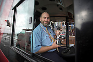 Gordon Cutting from Oxford after being presented with his trophy for winning the Bus Driver of the Year competition in Blackpool. The event, first staged in 1967, attracted 105 entrants from across the United Kingdom who completed theory and practical driving test to determine who would win the 2013 award.