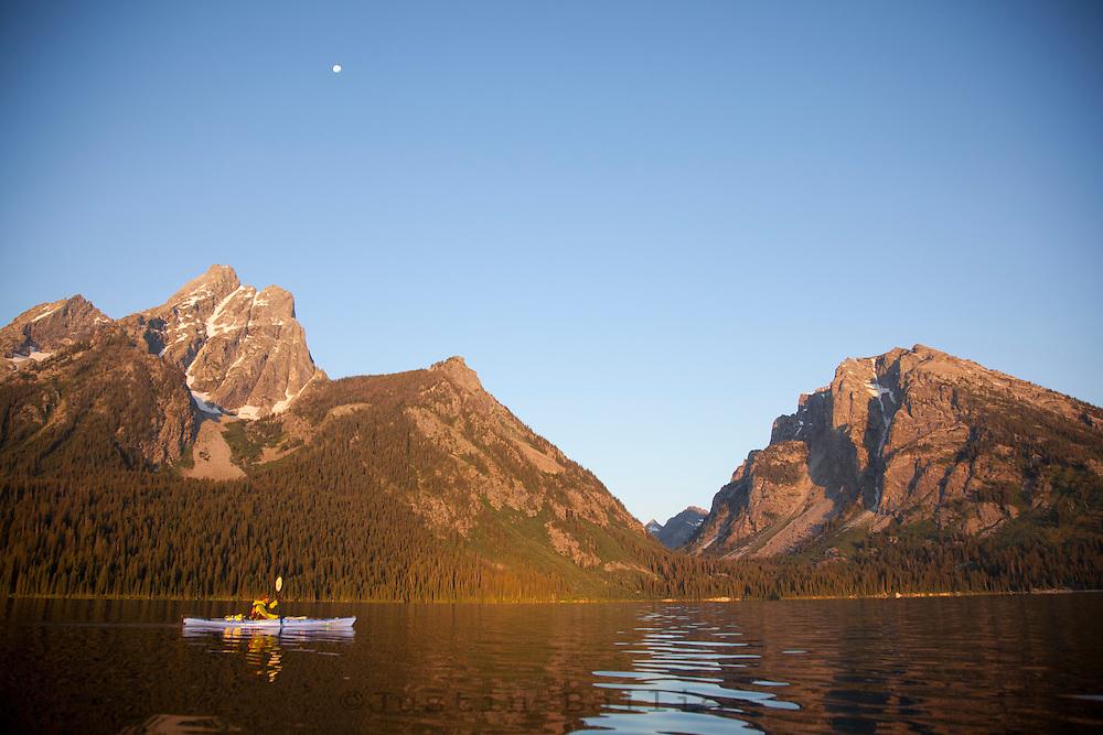 Sea kayaking Jackson Lake in Grand Teton National Park, WY.
