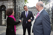 Repro Free: 15/10/2014 <br /> Kathleen O'Meara, head of advocacy and communications and John McCormack CEO, Irish Cancer Society are pictured with the Minister for Health Leo Varadkar T.D. as staff and supporters of the Irish Cancer Society gathered outside Leinster House to welcome the Government&rsquo;s decision to make the necessary investment to ensure BreastCheck will be extended to women aged between 65-69 years of age. The extension of screening to this age group will save a minimum of 87 lives per year.<br /> The Society has been campaigning for women in the 65-69 age group to be screened for breast cancer since 2011. One in ten of all breast cancers occur in women of this age.  The International Agency for Research on Cancer (IARC) says that quality screening mammography carried out every two years in women who are 50-69 years of age should reduce their risk of dying from breast cancer by about 35%. Picture Andres Poveda