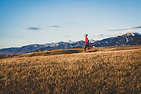 Inge Perkins out for a winter sunet run on the Tripple Tree Trail, Bozeman, Montana. The Bridger Range seen in the back drop.