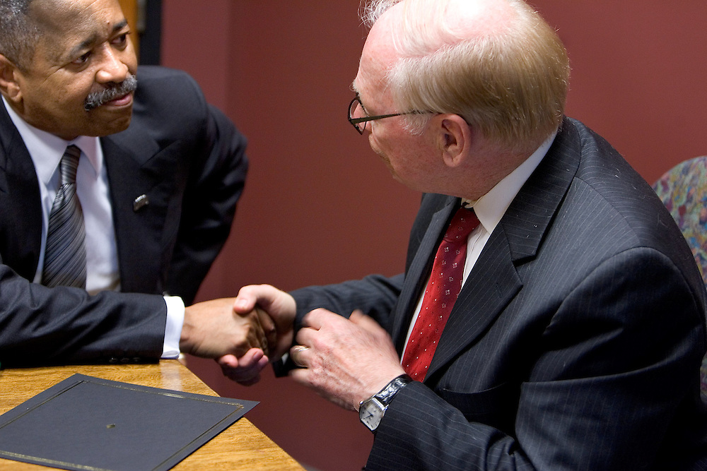 Ohio University's president, Roderick McDavis, and Hocking College's president, John Light, shake hands at the close of a press conference during which they signed an agreement making it easier for students to study at both colleges. Photographed at Hocking College on Monday, 3/12/07.