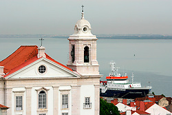 PORTUGAL LISBON 6OCT06 - Alfama district rooftops overlook the Rio Tejo. Alfama, originally a Moorish settlement, is Lisbon's traditional quarter characterised by Fado restaurants, narrow lanes and steep alleways.. . jre/Photo by Jiri Rezac. . © Jiri Rezac 2006. . Contact: +44 (0) 7050 110 417. Mobile:  +44 (0) 7801 337 683. Office:  +44 (0) 20 8968 9635. . Email:   jiri@jirirezac.com. Web:    www.jirirezac.com. . © All images Jiri Rezac 2006 - All rights reserved.