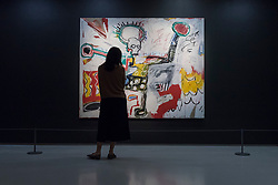 "© Licensed to London News Pictures. 20/09/2017. London, UK. A woman views ""Untitled"", 1982, by Jean-Michel Basquiat. Preview of ""Basquiat: Boom for Real"", the first large-scale exhibition in the UK of the work of American artist Jean-Michel Basquiat (1960-1988) taking place at the Barbican Art Gallery, 21 September-28 January 2018. Photo credit : Stephen Chung/LNP"